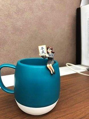 ジョージア缶コーヒーのノベルティについてる、平成のフチ子さん